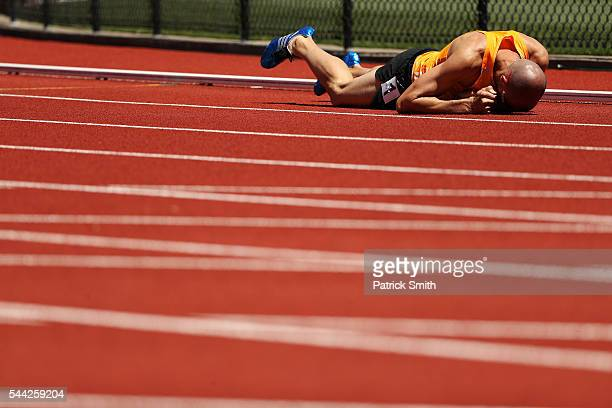 Jeremy Wariner falls to the track during the Men's 400 Meter Dash Semifinals during the 2016 US Olympic Track Field Team Trials at Hayward Field on...