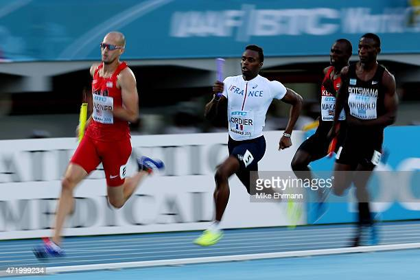 Jeremy Wariner of the United States leads Thomas Jordier of France during round one of the men's 4 x 400 metres relay on day one of the IAAF World...