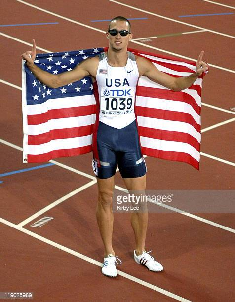 Jeremy Wariner of the United States takes a victory lap wiht American flag after winning the 400 meters in 4393 in the IAAF World Championships in...