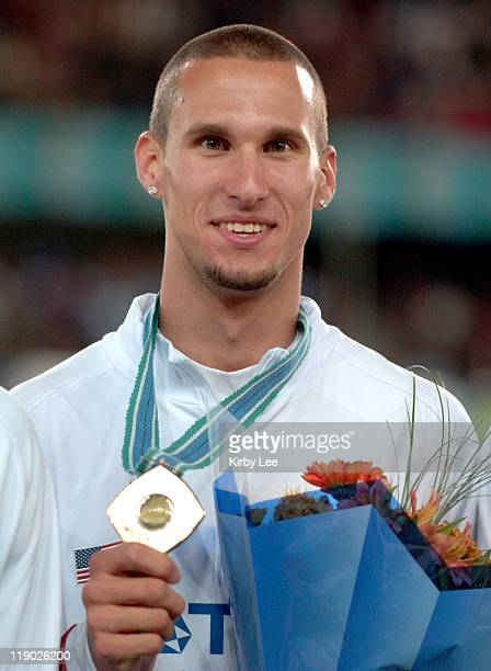 Jeremy Wariner poses with gold medal after anchoring United States 1600meter relay to victory in 25691 in the IAAF World Championships in Athletics...