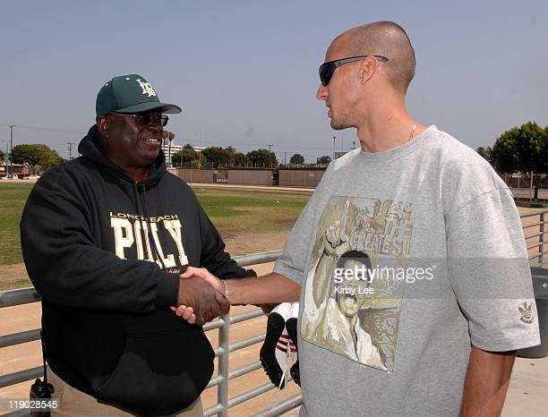 Jeremy Wariner the 2004 Olympic gold medallist in the 400 meters shakes hands with Long Beach Poly High School coach Don Norford in Long Beach Calif...