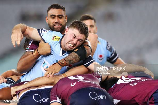 Jeremy Williams of the Waratahs is held back by Lukhan Salakaia-Loto of the Reds during the round 6 Super RugbyAU match between the NSW Waratahs and...
