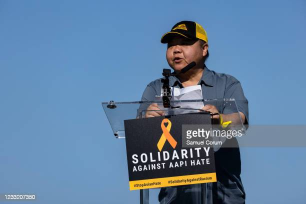 Jeremy Wu of APA Justice speaks during a rally on the National Mall on May 31, 2021 in Washington, DC. Members and allies of the Asian American...