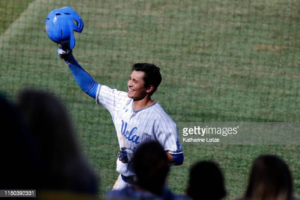 Jeremy Ydens of UCLA salutes the audience and the dugout following his home run during a baseball game against University of Washington at Jackie...