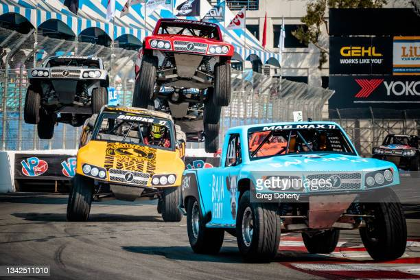 Jerett Brooks lands behind Mad Max Gordon at the Stadium Super Truck at the 2021 Acura Grand Prix Of Long Beach on September 25, 2021 in Long Beach,...