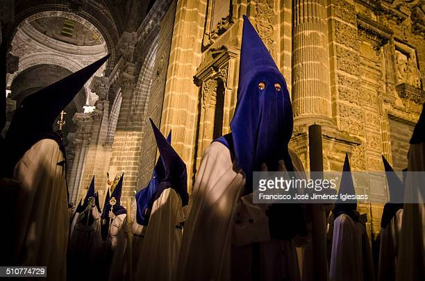 Jerez de la Frontera, Spain - 16 april, 2014: Penitents of brotherhood 'La Amargura' out of Jerez Cathedral. Christian celebration where death and...