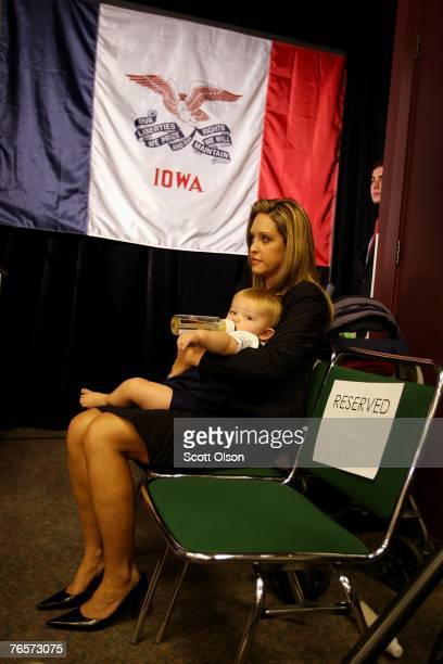 Jeri Thompson the wife of actor and former US Senator Fred Thompson holds her son Sammie while her husband delivers a speech September 7 2007 in...