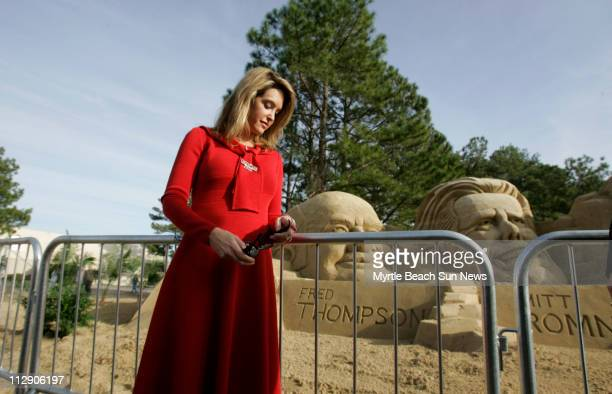 Jeri Thompson wife of republican presidential candidate Fred Thompson poses for photographers in front of the sand sculpture likeness of her husband...
