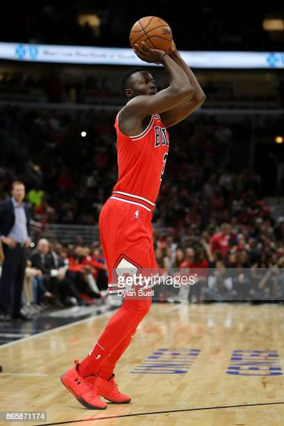 Jerian Grant of the Chicago Bulls attempts a shot in the first quarter against the San Antonio Spurs at the United Center on October 21 2017 in...