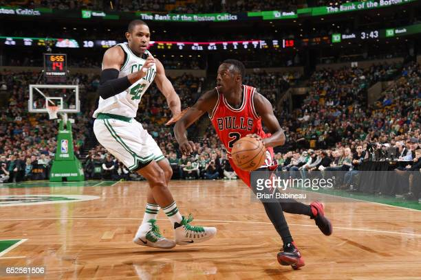Jerian Grant of the Chicago Bulls drives to the basket against Al Horford of the Boston Celtics against the Boston Celtics during the game on March...