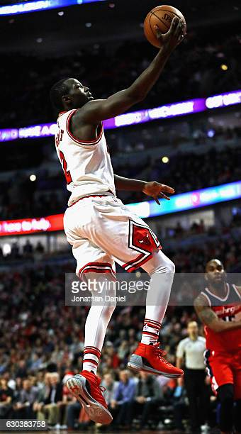 Jerian Grant of the Chicago Bulls drives to the basket against the Washington Wizards at the United Center on December 21 2016 in Chicago Illinois...