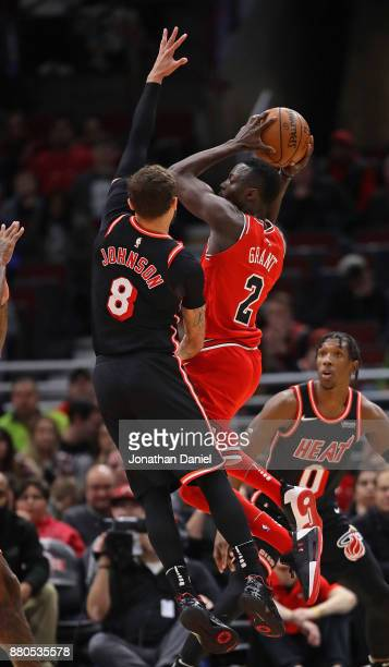 Jerian Grant of the Chicago Bulls goes up against Tyler Johnson of the Miami Heat at the United Center on November 26 2017 in Chicago Illinois The...