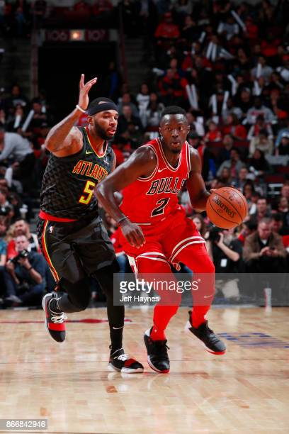 Jerian Grant of the Chicago Bulls handles the ball against Malcolm Delaney of the Atlanta Hawks on October 26 2017 at the United Center in Chicago...