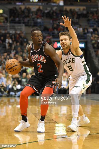 Jerian Grant of the Chicago Bulls is defended by Matthew Dellavedova of the Milwaukee Bucks during a game at the Bradley Center on December 26 2017...