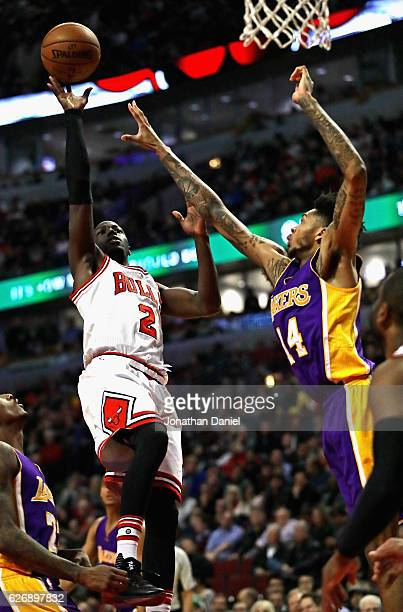Jerian Grant of the Chicago Bulls puts up a shot over Brandon Ingram of the Los Angeles Lakers at the United Center on November 30 2016 in Chicago...