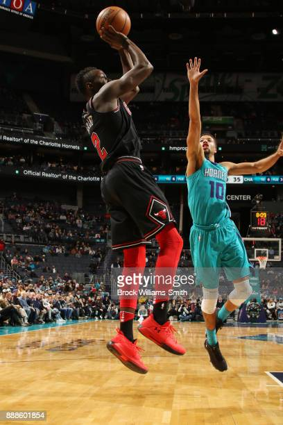 Jerian Grant of the Chicago Bulls shoots the ball against Michael CarterWilliams of the Charlotte Hornets on December 8 2017 at Spectrum Center in...