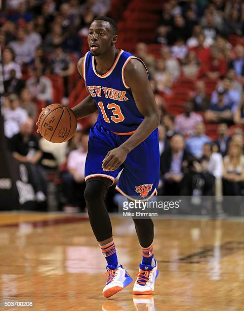 Jerian Grant of the New York Knicks looks to pass during a game against the Miami Heat at American Airlines Arena on January 6 2016 in Miami Florida...