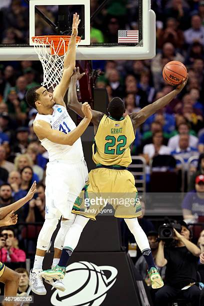 Jerian Grant of the Notre Dame Fighting Irish drives to the basket agianst Trey Lyles of the Kentucky Wildcats in the first half during the Midwest...