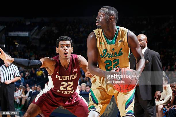 Jerian Grant of the Notre Dame Fighting Irish handles the ball against Xavier RathanMayes of the Florida State Seminoles during the game at Purcell...