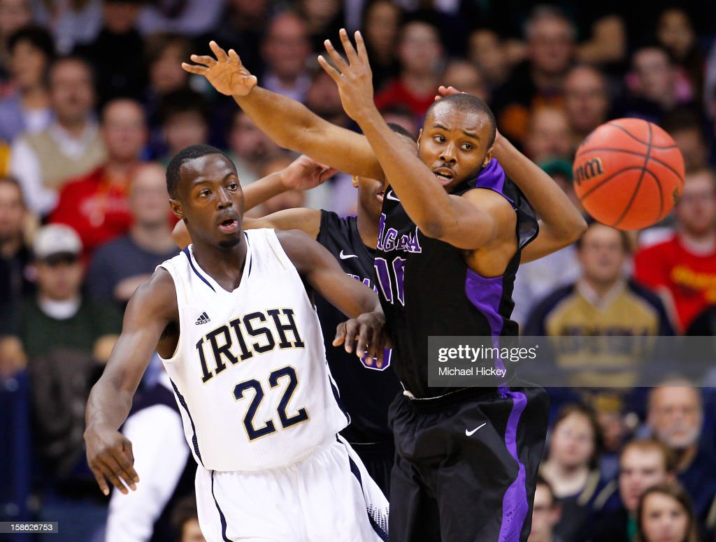 Jerian Grant #22 of the Notre Dame Fighting Irish passes the ball around Juan'ya Green #10 of the Niagara Purple Eagles at Purcel Pavilion on December 21, 2012 in South Bend, Indiana.