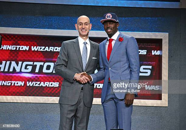 Jerian Grant shakes hands with NBA Commissioner Adam Silver after being selected number nineteen overall by theWashington Wizards during the 2015 NBA...