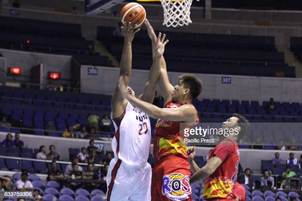Jericho Cruz of Rain or Shine blocks a layup attempt by Raymond Aguilar of Blackwater Showing their experience in doordie situations Rain or Shine...