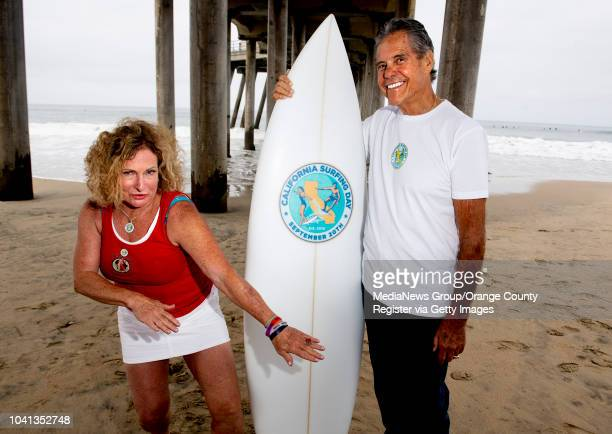 Jericho Poppler strikes a pose illustrating Stop Drop and Surf the catchphrase for California Surfing Day in Huntington Beach CA on Thursday...