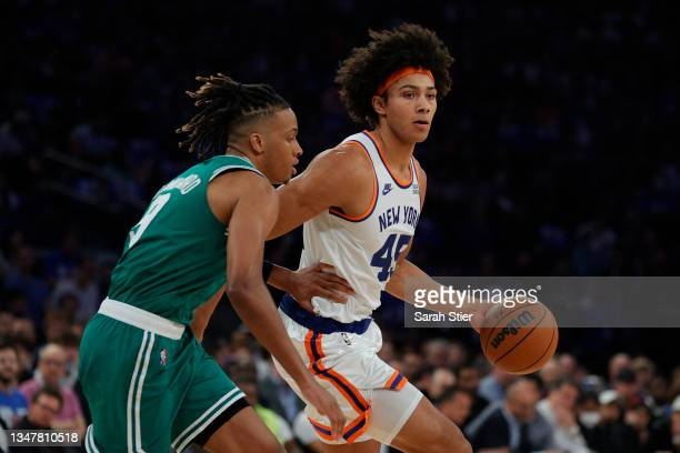 Jericho Sims of the New York Knicks dribbles against Romeo Langford of the Boston Celtics during the first half at Madison Square Garden on October...