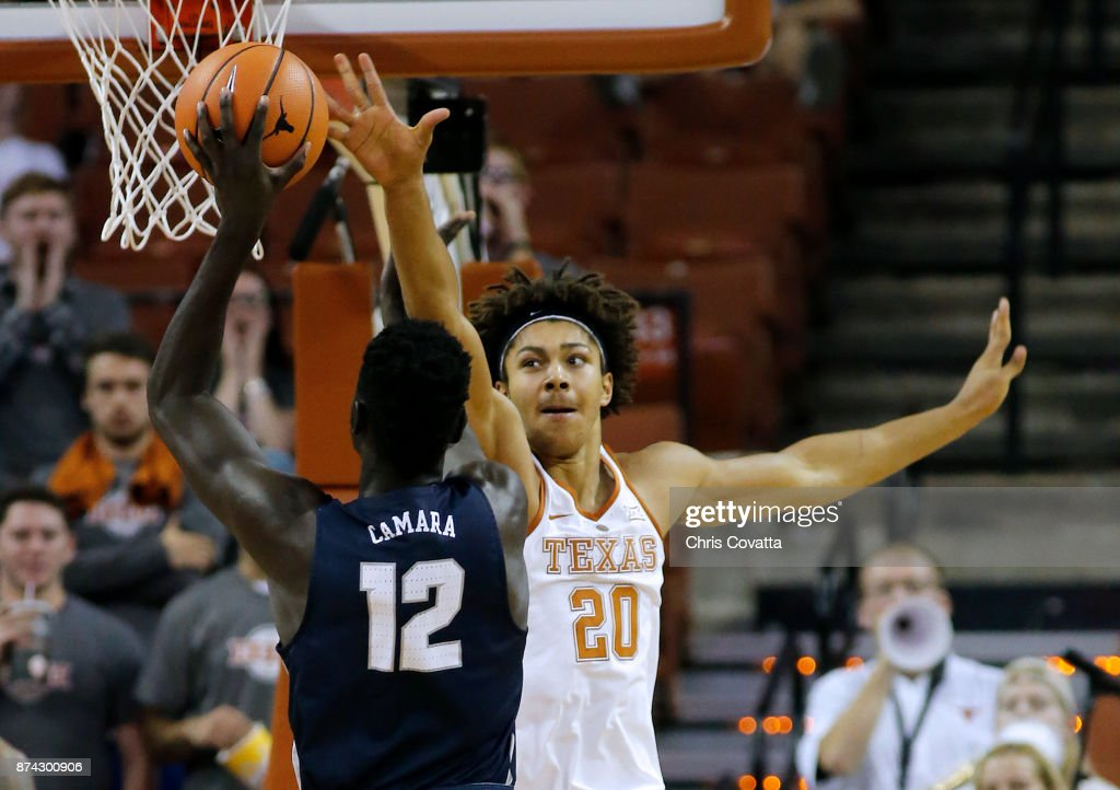 Jericho Sims #20 of the Texas Longhorns attempts to block a shot by Iba Camara #12 of the New Hampshire Wildcats at the Frank Erwin Center on November 14, 2017 in Austin, Texas.