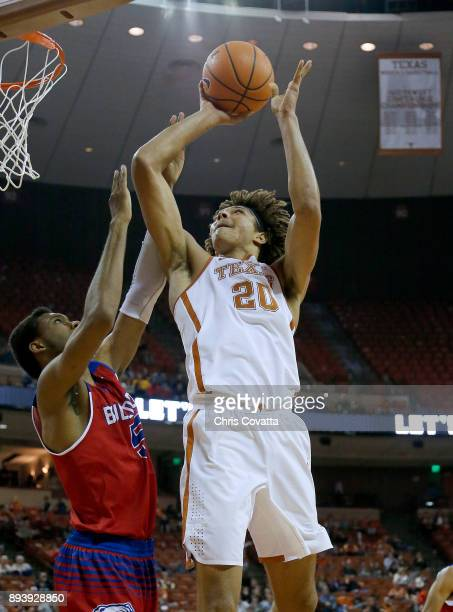 Jericho Sims of the Texas Longhornsn shoots over Joniah White of the Louisiana Tech Bulldogs at the Frank Erwin Center on December 16 2017 in Austin...