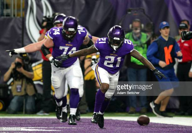 Jerick McKinnon of the Minnesota Vikings celebrates after scoring a 14 yard rushing touchdown in the first quarter of the NFC Divisional Playoff game...