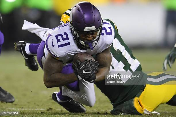Jerick McKinnon of the Minnesota Vikings dives for yards against the Green Bay Packers during the second half at Lambeau Field on December 23 2017 in...