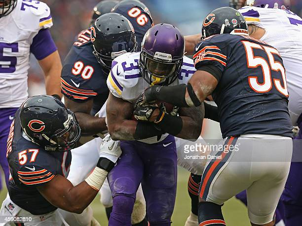 Jerick McKinnon of the Minnesota Vikings is stopped by Jon Bostic Jeremiah Ratliff and Lance Briggs of the Chicago Bears at Soldier Field on October...