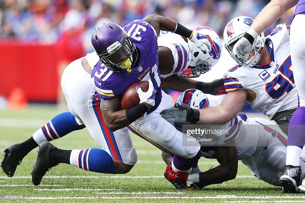 Jerick McKinnon #31 of the Minnesota Vikings runs the ball against the Buffalo Bills during the second half at Ralph Wilson Stadium on October 19, 2014 in Orchard Park, New York.