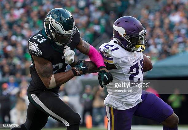 Jerick McKinnon of the Minnesota Vikings runs with the ball against Rodney McLeod of the Philadelphia Eagles at Lincoln Financial Field on October 23...