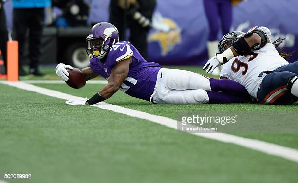 Jerick McKinnon of the Minnesota Vikings stretches for a touchdown against Will Sutton of the Chicago Bears during the second quarter of the game on...