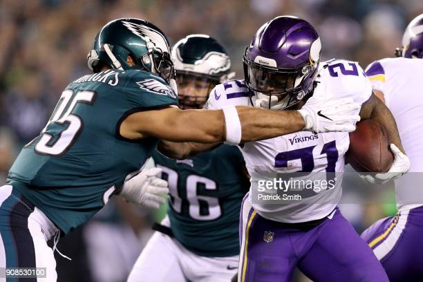 Jerick McKinnon of the Minnesota Vikings uses a stiff arm on Mychal Kendricks of the Philadelphia Eagles during the first quarter in the NFC...