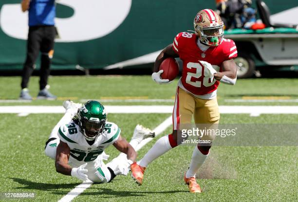 Jerick McKinnon of the San Francisco 49ers in action against Josh Adams of the New York Jets at MetLife Stadium on September 20 2020 in East...