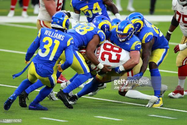 Jerick McKinnon of the San Francisco 49ers is tackled by the Los Angeles Rams during the fourth quarter at SoFi Stadium on November 29, 2020 in...