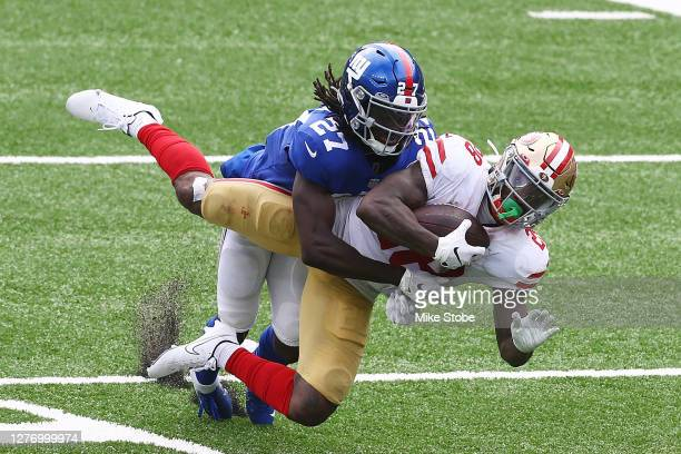 Jerick McKinnon of the San Francisco 49ers makes a diving catch against Isaac Yiadom of the New York Giants at MetLife Stadium on September 27 2020...