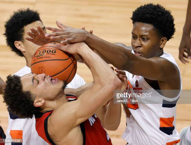 Jericole Hellems of the North Carolina State Wolfpack is blocked by Robert Braswell of the Syracuse Orange during the first half of their second...