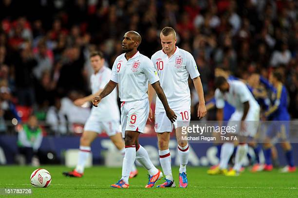 Jermain Defoe and Tom Cleverley of England walk back to the centre circle after the first Ukraine goal during the FIFA 2014 World Cup qualifier group...