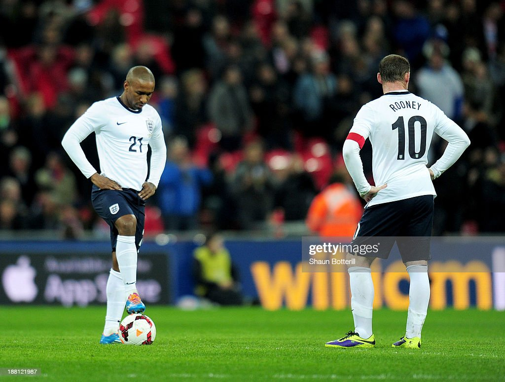 Jermain Defoe and Wayne Rooney (10) of England look dejected as Alexis Sanchez of Chile (not pictured) scores their second goal during the international friendly match between England and Chile at Wembley Stadium on November 15, 2013 in London, England.