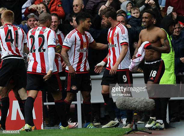 Jermain Defoe is surrounded by Sunderland players as they celebrate the third goal during the Barclays Premier League match between Sunderland and...
