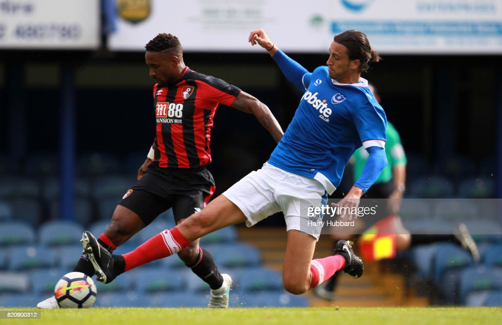 Jermain Defoe of AFC Bournemouth and Christian Burgess of Portsmouth in action during a pre-season friendly match between Portsmouth and AFC Bournemouth at Fratton Park on July 22, 2017 in Portsmouth, England.