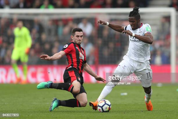 Jermain Defoe of AFC Bournemouth and Wilfried Zaha of Crystal Palace battle for the ball during the Premier League match between AFC Bournemouth and...
