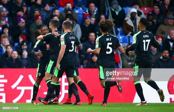Jermain Defoe of AFC Bournemouth celebrates after scoring his sides first goal with his AFC Bournemouth team mates during the Premier League match...