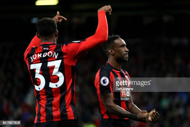 Jermain Defoe of AFC Bournemouth celebrates with teammate Jordan Ibe after scoring his team's second goal during the Premier League match between AFC...