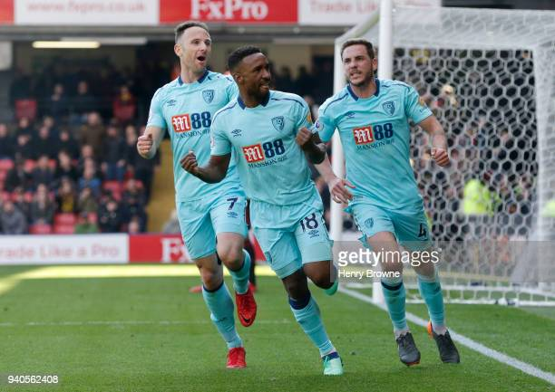 Jermain Defoe of AFC Bournemouth celebrates with teammates Marc Pugh and Dan Gosling after scoring his sides second goal during the Premier League...