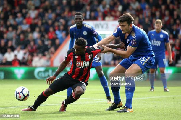 Jermain Defoe of AFC Bournemouth controls the ball under pressure of Harry Maguire of Leicester City during the Premier League match between AFC...